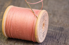 Spool of thread and needle Royalty Free Stock Images