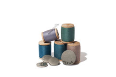 Spool of thread,needle and button isolated on white background.  Stock Photos