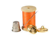 Spool of thread, needle, button and thimble Stock Photo