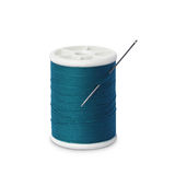 Spool of thread with needle Royalty Free Stock Photos