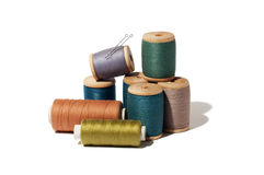 Spool of thread and needle isolated on white background.  Stock Images