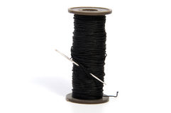 Spool of thread and needle isolated on white. Background Royalty Free Stock Photos