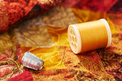 Spool of thread, needle and thimble Royalty Free Stock Images