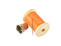 Spool of thread, needle and thimble Royalty Free Stock Photography