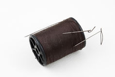 Spool of thread with needle Royalty Free Stock Photo