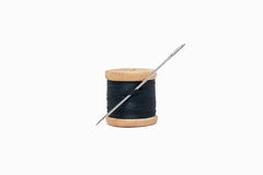 Spool of thread with needle. On a white background Royalty Free Stock Photos