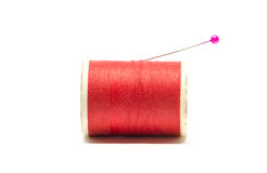 Spool of thread with needle. On white background Stock Photo