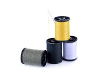 Spool of thread and needle on white background. Spool of thread and needle on a white background Stock Photos
