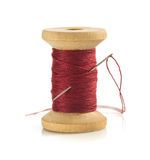 Spool of thread and needle on white. Spool of thread and needle  on white background Stock Images