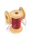 Spool of thread and needle on white. Spool of thread and needle  on white background Stock Photos