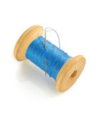 Spool of thread and needle on white. Spool of thread and needle  on white background Royalty Free Stock Photo