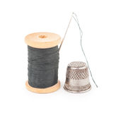 Spool of thread with needle Stock Photography