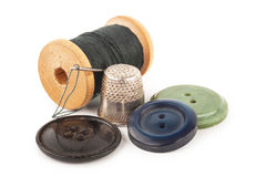 Spool of thread with needle Stock Images