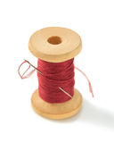 Spool of thread and needle on white. Spool of thread and needle isolated on white background Royalty Free Stock Photo