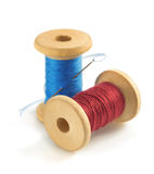 Spool of thread and needle on white. Spool of thread and needle isolated on white background Stock Photo