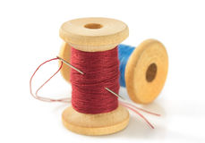 Spool of thread and needle on white. Spool of thread and needle isolated on white background Stock Images