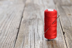 Spool of thread and needle Stock Image