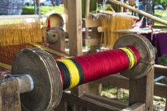Spool of thread for the old loom Royalty Free Stock Image
