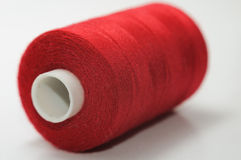 Spool of thread. One red big spool of thread Stock Images