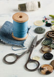 Spool of thread and scissors Stock Images