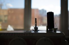 Spool of thread on the sewing machine close-up silhouette stock photo
