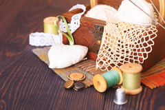Spool of thread, thimble and a box with needlework Stock Photography
