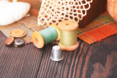 Spool of thread, a thimble and box with needlework Royalty Free Stock Photos
