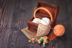 Spool of thread, thimble and a box with needlework Stock Photos