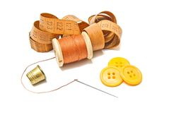 Spool of thread, thimble and buttons Royalty Free Stock Image