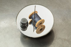Spool of thread, thimble and needle  Royalty Free Stock Image