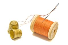 Spool of thread, and thimbles Royalty Free Stock Image