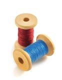 Spool of thread on white Stock Photo