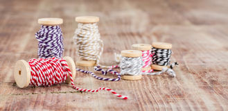 Spool of thread  on wooden table Royalty Free Stock Images