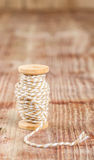 Spool of thread  on wooden table Stock Photo