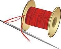 Spool with threads and needle Royalty Free Stock Image