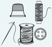 Spool with threads, sewing button and thimble Stock Image