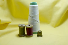 Spool of treads, thimble and a needleand a needle Royalty Free Stock Photography