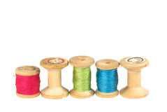 Spools. Old wooden reels of thread on white Stock Photo