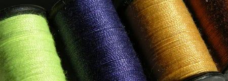Spools of color. Ed threads closeup Stock Photos