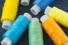 Colored spools with threads close up Royalty Free Stock Photo
