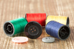 Spools of colored thread and buttons Stock Image