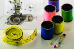 Spools of colored thread tape, needle for sewing machine closeup. royalty free stock photo