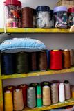 spools of colored thread in the workshop royalty free stock images