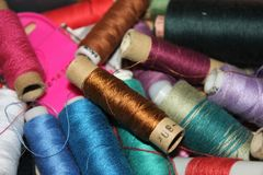 Closeup Group of colorful spools of thread use to sewing, needlework and embroidery royalty free stock image