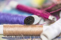 Spools of colorful thread, needle Royalty Free Stock Photo