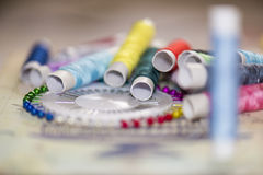 Spools of colorful thread, needles Royalty Free Stock Photography
