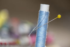 Spools of colorful thread, needles Stock Images