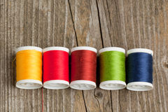 Spools of colorful threads Stock Photo