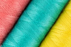 Spools of colorful threads in a row. Closeup Stock Photo