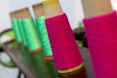 Spools of colorful yarn on a table. Ready to be knitted Royalty Free Stock Image